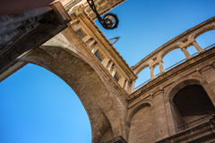 Perspective view of an ancient arch between Cathedral and Basilica Desamparados Stock Photo