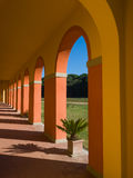 Perspective view of an arched walkway  in a sunny day Royalty Free Stock Image