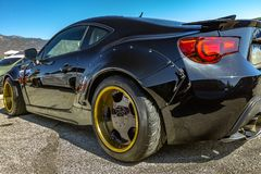 Perspective view of a black car from the back driver side Royalty Free Stock Photos