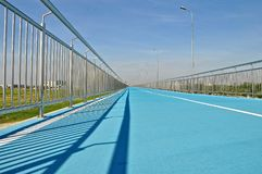 Blue cycle track royalty free stock photography