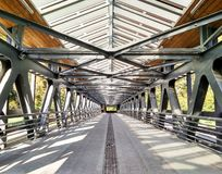 Perspective view of bridge or cross walk. With metal construction royalty free stock photo