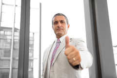 Perspective view of a business man with thumbs up Royalty Free Stock Photos