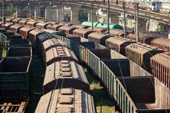Perspective view cargo freight trains depot. Many freight train wagons Royalty Free Stock Photos