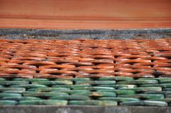 Perspective view of clay temple roof tiles stock images