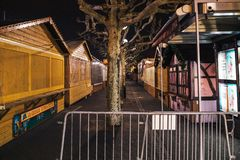 Empty closed christmas market stalls in Strasbourg after attacks. Perspective view of Closed Christmas Market stalls chalets after terrorist attack of Cherif stock photo