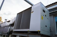 Perspective view of the gray commercial cooling unit for central ventilation system. Perspective view of the commercial cooling unit for central ventilation stock photo