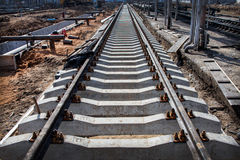 Perspective view of Concrete railroad ties in railway construction site Royalty Free Stock Photo