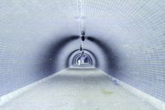 Perspective View Through a Dark Tunnel With Human Silhouette (Negative) Royalty Free Stock Photos