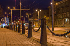 Perspective view of decorative poles and chain Royalty Free Stock Images