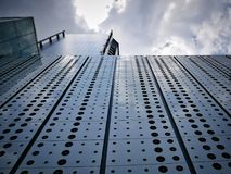 Perspective View Directly Below Urban Office Building. In Cloudy Sky Royalty Free Stock Image