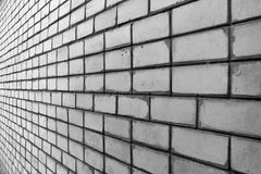 Perspective view of dirty white silicate brick wall. Perspective view of white silicate brick wall Royalty Free Stock Images