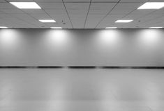 Perspective view of Empty Space Classic Monotone Black White Office Room with Row Ceiling LED Light Lamps and Lights Shade on Wall Royalty Free Stock Images