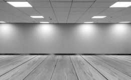 Perspective view Empty Space Monotone Black White Office Room with Row Ceiling LED Light Lamps and Lights Shade on Wall. With Wooden Panel Floor for Gallery stock photos