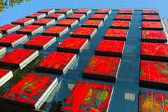 Horwath HTL Spain hotel. Modern facade made of colorful red blocks and glass walls. Stock Image