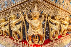 Perspective view of golden religious statue Statue Garuda in wat phra kaew temple. Bangkok, Thailand Royalty Free Stock Photography
