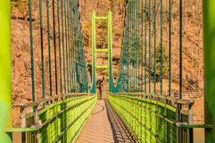 Perspective view of green footbridge Stock Images