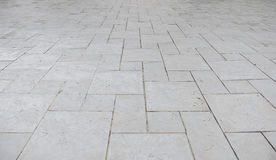 Perspective view of Grunge White Square Brick Stone on The Ground for Street Road. Sidewalk, Driveway, Pavers Stock Images