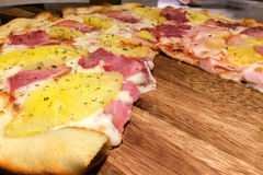 Perspective View of Hot Homemade Traditional Classic Italian Pizza Slice with Meting Cheese, Ham and Pineapple Royalty Free Stock Photo