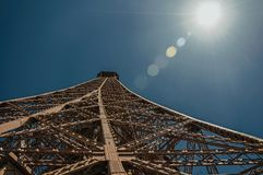 Perspective view of the iron structure from the top of Eiffel Tower with sunshine in Paris. Royalty Free Stock Photography