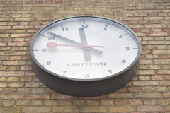 Perspective view of a large white clock showing the time in capetown Royalty Free Stock Images