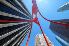 Perspective view of Los Angeles office buildings against blue sky. Up view under Four Arches monument Stock Photos