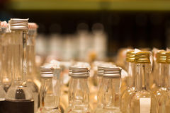 Miniature alcohol bottles in store Stock Photography