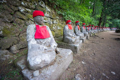 Perspective view, moss covered statues of Jizo in Nikko Stock Image