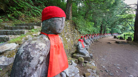 Perspective view, moss covered statues of Jizo in Nikko Stock Images