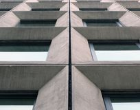 Free Perspective View Of Geometric Angular Concrete Windows On The Facade Of A Modernist 1960s Brutalist Style Building Stock Images - 150982914