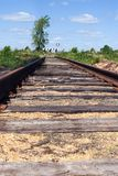 Perspective view of the old abandoned rusty railway tracks in deadlock. stock images
