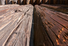 Perspective view of old cracked logs. royalty free stock image