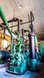 Perspective view of old machine for freezer pipes green valves royalty free stock images