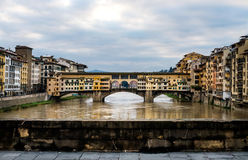 Perspective view of Old Ponte Vecchio Bridge on dull day, Florence, Italy Stock Image