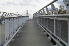 Pedestrian bridge with white railing Stock Image