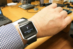 Perspective view person reading watch with heart tracker during Royalty Free Stock Images