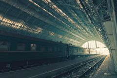 Perspective view of a platform with old train. Perspective view of a platform with outdated train standing in Lviv, Ukraine. Vintage style color tone Royalty Free Stock Images