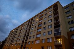 Perspective view of a prefab houses built in communism era at twilight. Perspective view of a prefab houses built in communism era which were recently royalty free stock photos