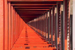 Perspective view of the red beach huts. Infinite background royalty free stock image