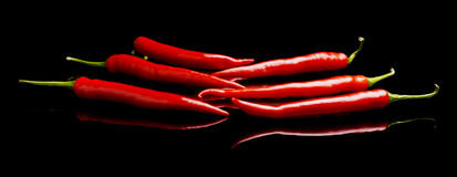 Perspective view of red peppers isolated black background Stock Photo