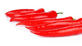 Perspective view of red peppers  white background. Perspective view of chilli red peppers  on white background Stock Photo
