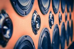 Perspective View of Rows of Sound Speakers on Light Warm Orange Background.  royalty free stock images