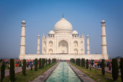 A perspective view on Taj-Mahal mausoleum with reflection in water. Agra, India. Stock Images
