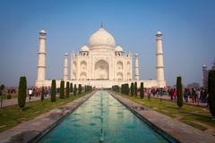 A perspective view on Taj-Mahal mausoleum with reflection in water. Agra, India. Royalty Free Stock Photography