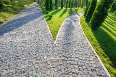 Perspective view of two cobblestone roads decision Royalty Free Stock Images