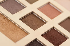Perspective view of vintage makeup kit. Perspective view of makeup kit with vintage colors and nuances Royalty Free Stock Photo