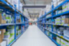 Perspective view on a warehouse with consumer products in blur stock image