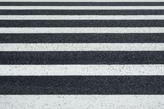 Perspective view of white markings crosswalk lines on a asphalt. Perspective view of white markings pedestrian lines on a asphalt road background Royalty Free Stock Photos