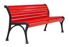 Perspective view on a wooden bench painted in red with black metal legs, isolated on a white. Perspective view on a colorful wooden bench painted in red with stock photo