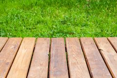 Perspective view of new wooden boardwalk royalty free stock photo