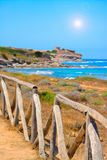 Perspective view of a wooden palisade by the sea Stock Photography